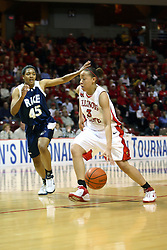 15 March 2007: Tamara Butler moves past a surprised Tiffany Loggins. The Owls of Rice university visited the Redbirds of Illinois State University at Redbird Arena in Normal Illinois for a round one WNIT game.