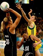 Melbourne 2006 Commonwealth Games Day 11.  Netball. Gold Medal Game. Australia v New Zealand. Janine Litich jumps over Belinda Colling to defend Irene Van Dyke