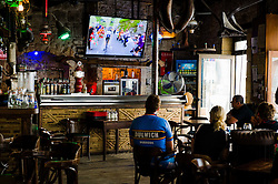 Watching the tour de France in a bar in Issigeac, France<br /> <br /> (c) Andrew Wilson | Edinburgh Elite media