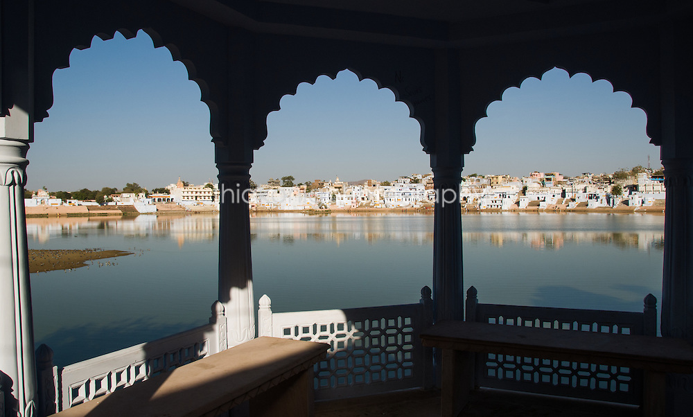 Looking out through distinctive arches to Pushkar Lake, India