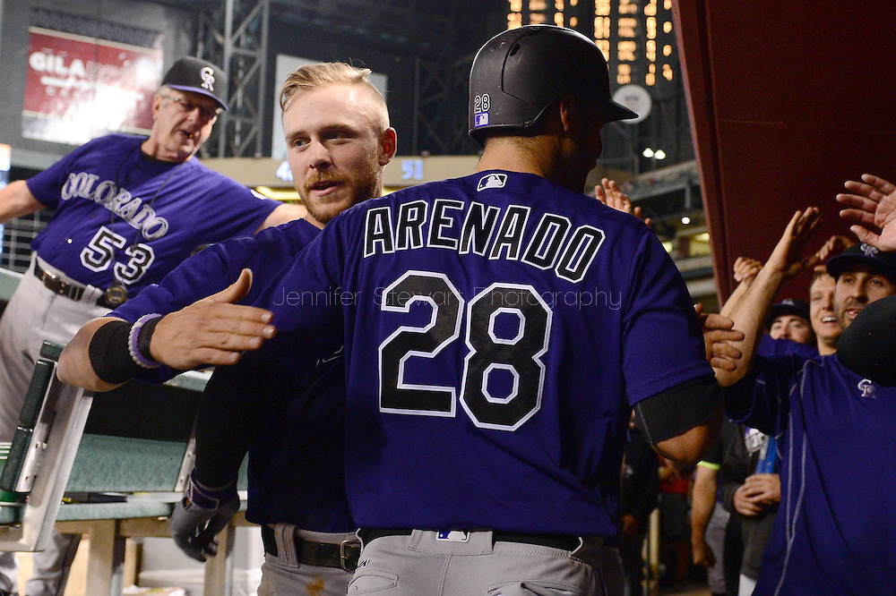 Apr 29, 2016; Phoenix, AZ, USA; Colorado Rockies Nolan Arenado (28) is congratulated by teammate Trevor Story (27) after hitting a solo home run during the fifth inning against the Arizona Diamondbacks at Chase Field. Mandatory Credit: Jennifer Stewart-USA TODAY Sports