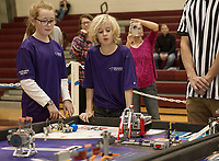 Grace Burnett and Austin Dow with Team Beta from Concord in the First Lego League Competition Saturday at Gilford Middle School.  (Karen Bobotas/for the Laconia Daily Sun)
