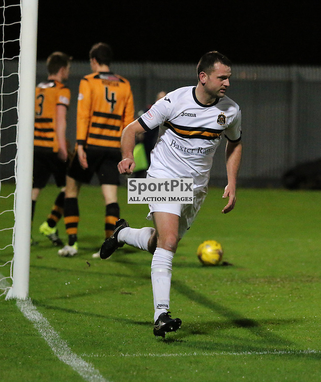 Garry Fleming makes in two for dumbarton during the Dumbarton v Alloa  Scottish Cup  8 December 2015 <br /> <br /> (c) Andy Scott | SportPix.org.uk