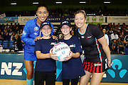 ANZ Future Captains Paris Robson aged 10 (L) and Eva White aged 12 (R) with Maria Tutaia of the Mystics and Anna Thompson of the Tactix. 2015 ANZ Championship, Northern Mystics v Canterbury Tactix, The Trusts Arena, Auckland, New Zealand. 3 May 2015. Photo: Anthony Au-Yeung / www.photosport.co.nz