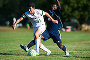 Rice's Sam Dickin (11) runs past Burlington's Maenda Bienfait Badibang (21) with the ball during the boys soccer game between the The Burlington Seahorses and the Rice Green Knights at Rice Memorial high School on Tuesday afternoon September 15, 2015 in South Burlington, Vermont. (BRIAN JENKINS/for the FREE PRESS)