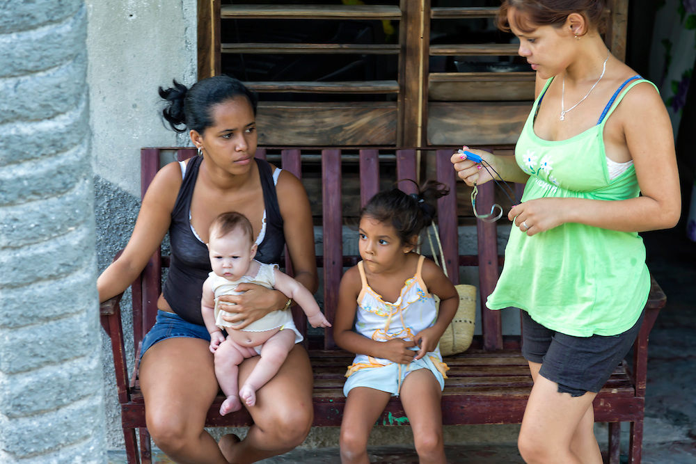 Women with children in Charco Redondo, Granma, Cuba.