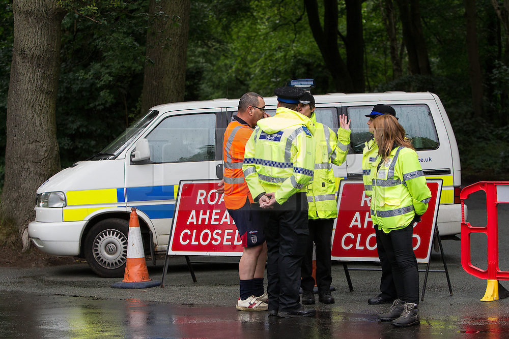 © Licensed to London News Pictures . 01/08/2015 . Cheshire , UK . Police blocking Coach Road , along which the plane has crashed . Scene in Oulton Park , Cheshire , where a plane has crashed and one person has died this afternoon (1st August 2015) during the Carfest2015 event . Photo credit : Joel Goodman/LNP