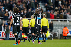 Moussa Sissoko of Newcastle United celebrates and applauds the supporters after Newcastle win 2-1 to inflict a first defeat in all competitions this season on Chelsea - Photo mandatory by-line: Rogan Thomson/JMP - 07966 386802 -06/12/2014 - SPORT - FOOTBALL - Newcastle, England - St James' Park - Newcastle United v Chelsea - Barclays Premier League.