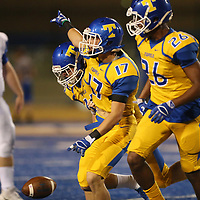 Tupelo's Clay Cox celebrates with teammates after intercepting the ball during Friday night's game against Oxford.