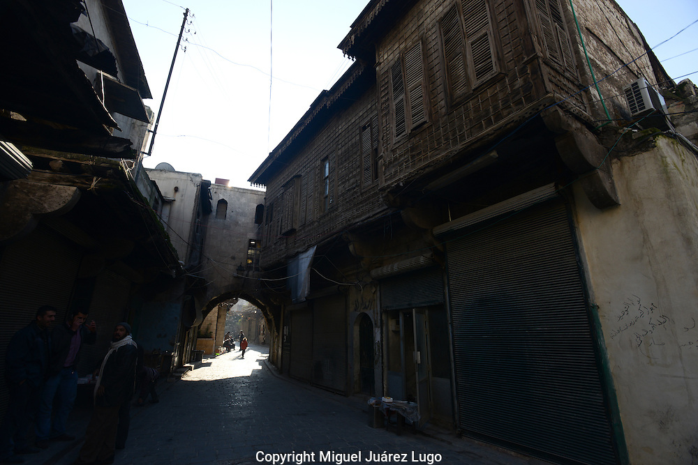 Aleppo, Syria, January, 2013 -  In the Bab al-Nasr neighborhood of Old City Aleppo, some old houses have survived the fighting with their old Ottoman balconies in tact. Many others have been set on fire or shot up by the Syrian Army. (Photo By Miguel Juárez Lugo)