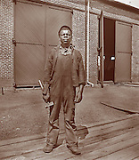 Vintage Photo: Black railroad worker poses with a hammer, circa 1900 probably in Virginia.