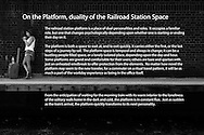 The railroad station platform is a place of dual personalities and roles. It occupies a familiar role, but one that changes psychologically depending upon whether one is starting or ending their day on it.<br /> <br /> The platform is both a space to wait at, and to exit quickly. It carries either the first, or the last steps of a journey by rail. The platform space is temporal and always in change; it can be a bustling people filled space, or a lonely isolated place, depending upon the day and hour. Some platforms are grand and comfortable for their users; others are bare and spartan with just an unheated windbreak to offer protection from the elements. No matter how novel the platform may seem to the new traveler, for a commuter on a ritual travel pattern, it will be as much a part of the workday experience as being in the office itself. <br /> <br /> From the anticipation of waiting for the morning train with its warm interior to the loneliness of the solitary walk home in the dark and cold, the platform is in constant flux. Just as sudden as the train&rsquo;s arrival, the platform quickly transforms to its next personality.