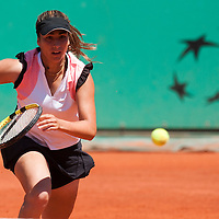 31 May 2009: Aravane Rezai of France runs for the ball during the Women's Singles fourth round match on day eight of the French Open at Roland Garros in Paris, France.