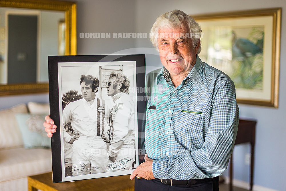 Brian Redman poses for a portrait on 6/26/2017 in Vero Beach.Brian Redman holds a photo of himself and Steve McQueen that was taken during the filming of the 1971 movie Le Mans.