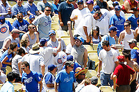 4 May 2011: Fan catches a foul ball during the 6th inning while the Cubs defeated the Dodgers 5-1 during a Major League Baseball game at Dodger Stadium in Los Angeles, California.  Dodgers players are wearing Brooklyn Dodger 1940's throwback jersey uniforms and the Cubs are also wearing throwback retro jersey uniforms. **Editorial Use Only**