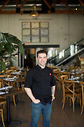 JERSEY CITY, NJ - March 11, 2015: Chef Ryan DePersio in the dining room of Battello on the waterfront.<br /> <br /> CREDIT: Clay Williams for Edible Jersey.<br /> <br /> © Clay Williams / claywilliamsphoto.com