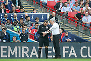 Manchester United Manager Jose Mourinho demonstrates time with his watch during the The FA Cup Semi Final match between Manchester United and Tottenham Hotspur at Wembley Stadium, London, England on 21 April 2018. Picture by Phil Duncan.