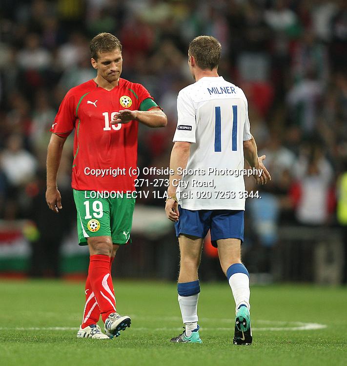 03/09/2010 International football. England v Bulgaria.<br /> Dejection for Bulgarian captain Stiliyan Petrov as he shakes hands with former Villa colleague James Milner.<br /> Photo: Mark Leech.