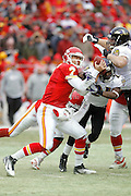 Paul Kruger (99) and Lardarius Webb (21) of the Baltimore Ravens force a fumble from Matt Cassel of the Kansas City Chiefs during the AFC Wild Card Playoff game at Arrowhead Stadium on Jan. 9, 2011 in Kansas City, MO.