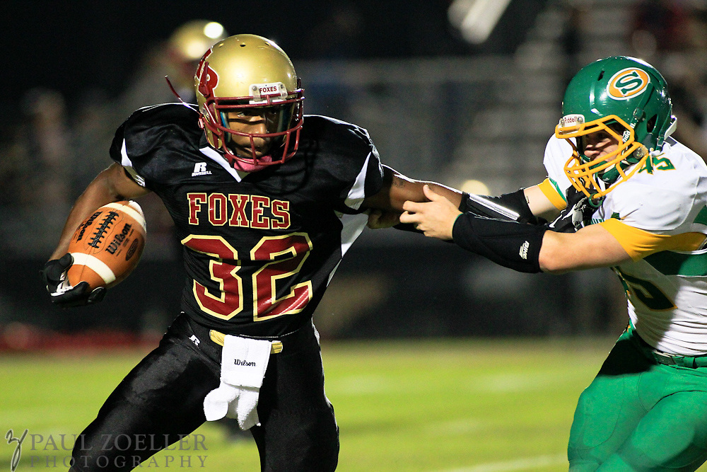Ashley Ridge's Vernon Moree runs with the ball as Summerville's Matt Powell tries to tackle him Friday, Oct. 26, 2012 at Ashley Ridge High School in Summerville. Paul Zoeller/Special to the Post and Courier