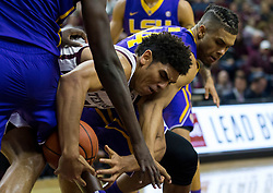 Texas A&M center Tyler Davis (34) and LSU forward Wayde Sims (44) fight for a loose ball during the first half of an NCAA college basketball game Saturday, Jan. 6, 2018, in College Station, Texas. (AP Photo/Sam Craft)