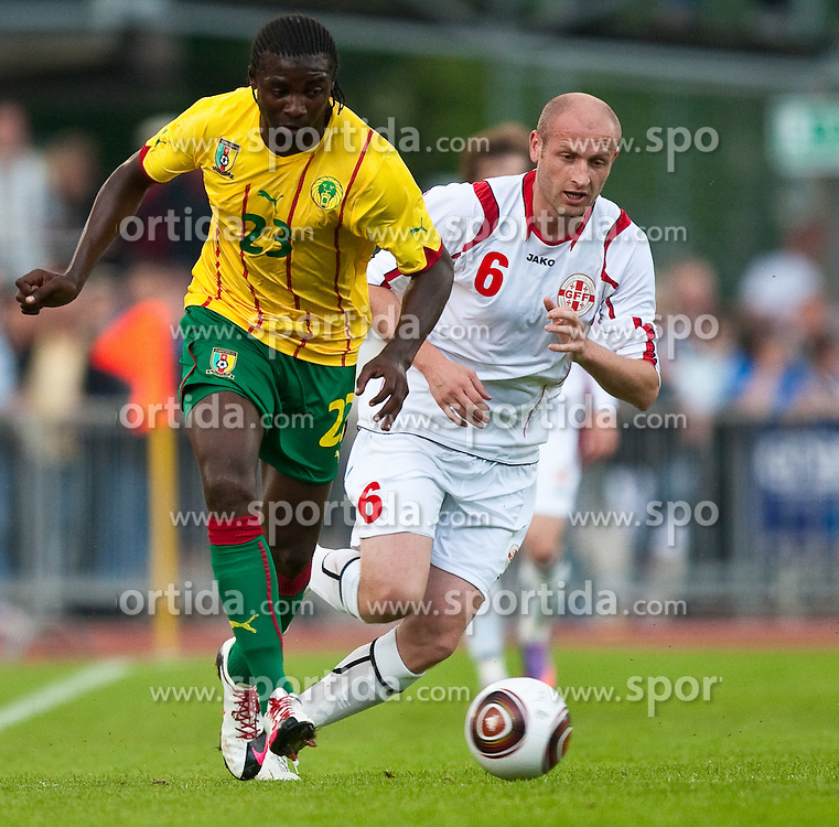 25.05.2010, Dolomitenstadion, Lienz, AUT, FIFA Worldcup Vorbereitung, Kamerun vs Georgien im Bild 23, KOUEMAHA Dorge, FW, Club Brugge, Kamerun, Aleksandre Amisulashvili (GEORGIA)., EXPA Pictures © 2010, PhotoCredit: EXPA/ J. Feichter / SPORTIDA PHOTO AGENCY