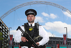 """Police presence outside the stadium during the Emirates FA Cup Final at Wembley Stadium, London. PRESS ASSOCIATION Photo. Picture date: Saturday May 27, 2017. See PA story SOCCER Final. Photo credit should read: Nick Potts/PA Wire. RESTRICTIONS: EDITORIAL USE ONLY No use with unauthorised audio, video, data, fixture lists, club/league logos or """"live"""" services. Online in-match use limited to 75 images, no video emulation. No use in betting, games or single club/league/player publications"""