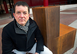© Licensed to London News Pictures. 13/12/11 London, UK. .Antony Gormley unveils his new sculpture, 'Witness' outside The British Library, London. The piece was commissioned by English PEN to mark it's 90th anniversary and is cast in iron depicting an empty chair to represent writers around the world..Photo credit : Simon Jacobs/LNP
