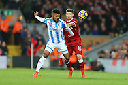 Elias Kachunga of Huddersfield Town (l) and Alberto Moreno of Liverpool battle for the ball. Premier League match, Liverpool v Huddersfield Town at the Anfield stadium in Liverpool, Merseyside on Saturday 28th October 2017.<br /> pic by Chris Stading, Andrew Orchard sports photography.