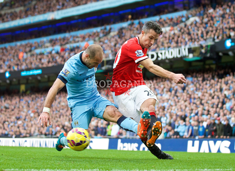 MANCHESTER, ENGLAND - Sunday, November 2, 2014: Manchester City's Pablo Zabaleta in action against Manchester United's Robin van Persie during the Premier League match at the City of Manchester Stadium. (Pic by David Rawcliffe/Propaganda)