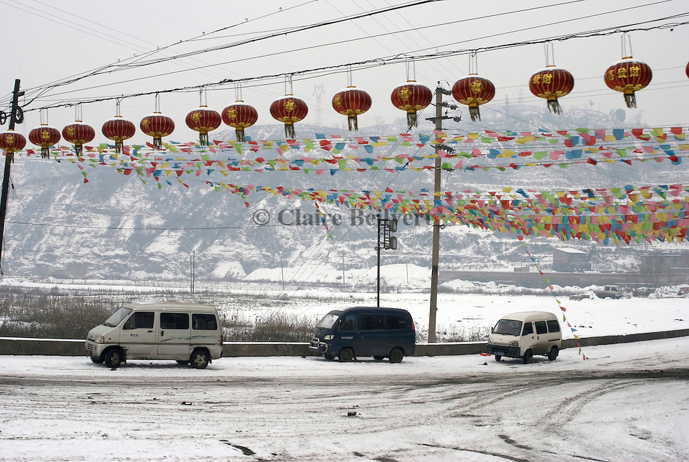 Vans on a Shanxi Province road.