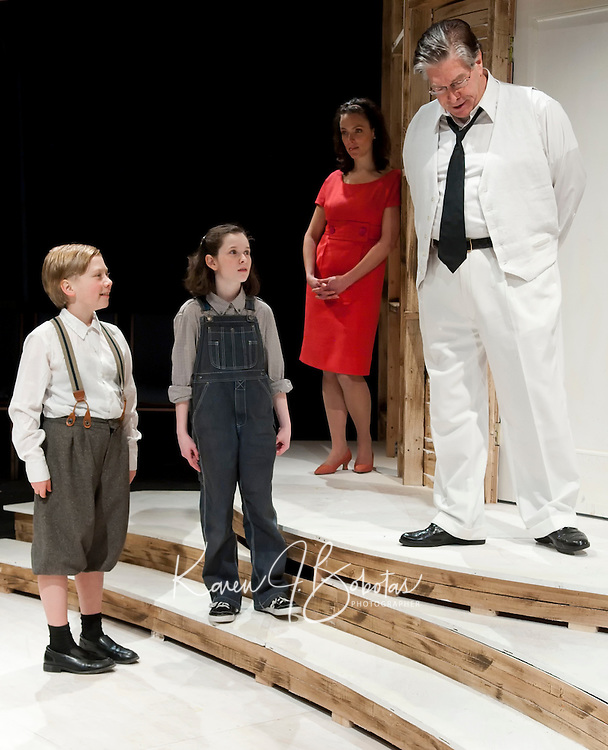 """Dill (Nevis Van Ooijen), Scout (Jaydie Becket Halperin), Atticus Finch (Steven Raymond) and Narrator Jean Louise Finch (Scout grown up played by Tamara McGonagle) during the Winni Playhouse dress rehearsal for """"To Kill a Mockingbird"""" Wednesday evening.   (Karen Bobotas/for the Laconia Daily Sun)"""