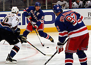 Jaromir Jagr of the New York Rangers brings the puck up ice before scoring  a goal 29 seconds into the game against the Washington Capitals  at Madison Square Garden in New York Thursday 05 October 2006.<br />