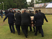 "5/30/15 Indianola, BB Kings band members carry the casket bearing his body to its final resting place outside his museum in Indianola Mississippi. Fans to see B. B Kings final home coming funeral procession outside the BB King Museum. A family member reaches out to touch the casket for one last time at the gravesite of Mr. King during the burial outside in the rain. The Thrill is gone, the casket holding the body of BB King arrives at the Bell Grove Missionary Baptist Church for his final homecoming. Blues legend B.B. King is is laid to rest in the shadow of the cotton gin at the B.B. King Museum and Interpretive Center. Mr King's final homecoming procession included a black horse WITH A saddle flanked with two of BB's famous ""Lucielle"" guitars signed by Mr. King. Fans lined the streets to watch the procession and pay their respect to the King of the Blues. Photo ©Suzi Altman"