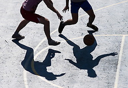 © London News Pictures. 09/03/2014. Brighton UK. Members of the public enjoy a game of basketball during warm weather on Brighton Seafront. With Temperatures expected to hit 18 degrees over the weekend, areas of England are set for the warmest temperatures this year. Photo credit: LNP