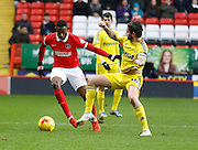 Charlton Athletic midfielder El-Hadji Ba keeps the ball from Nottingham Forest midfielder Henri Lansbury during the Sky Bet Championship match between Charlton Athletic and Nottingham Forest at The Valley, London, England on 2 January 2016. Photo by Andy Walter.