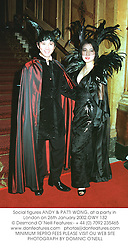 Social figures ANDY & PATTI WONG, at a party in London on 26th January 2002.OWY 132