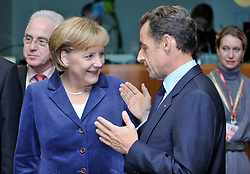"Angela Merkel, Germany's chancellor, left, speaks with Nicolas Sarkozy, France's president, during the European Union Summit at the EU headquarters in Brussels, Belgium, on Thursday, Oct. 29, 2009. European Union leaders are set for ""very difficult"" talks to overcome the Czech Republic's resistance to a new governing treaty designed to strengthen the EU's influence in world affairs, Reinfeldt said. (Photo © Jock Fistick)"