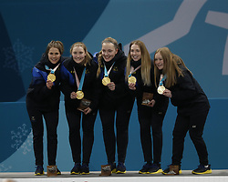 February 25, 2018 - Pyeongchang, South Korea - Sweden players including Anna Hasselborg, Sara McManus , Agnes Knochenhauer , Sofia Mabergs and Jennie Waahlin celebrate on the podium after the women's curling gold medal game during the Pyeongchang 2018 Olympic Winter Games at Gangneung Curling Centre. (Credit Image: © David McIntyre via ZUMA Wire)