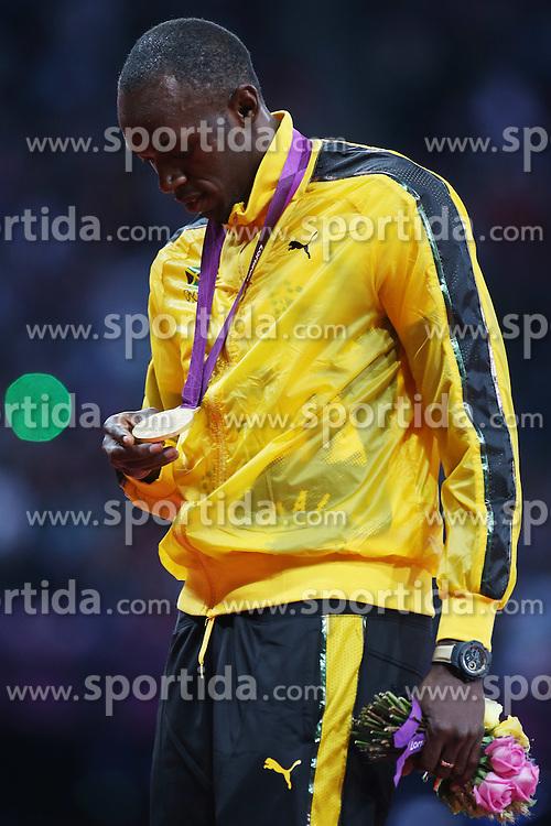 Olympics - London 2012 Olympic Games - 6/8/12.Athletics - Men's 100m Final - Jamaica's Usain Bolt celebrates winning Gold.© pixathlon