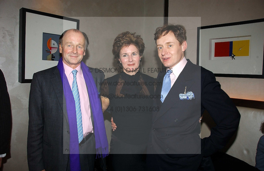 Left to right, SIMON PARKER-BOWLES and NICK & ALEX FOULKES at a party to celebrate the publication of 'Dancing into Waterloo' by Nick Foulkes held at The Westbury Hotel, Conduit Street, London on 14th December 2006.<br /><br />NON EXCLUSIVE - WORLD RIGHTS