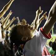 A young Vasco fan celebrates after his side had taken the leader with a goal from Vasco striker Eder Luis during the Vasco V Atletico MG during the Brasileiro  league match as São Januário Stadium. the match ended in a 1-1 draw, Rio de Janeiro, Brazil. 9th September 2010. Photo Tim Clayton.