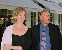 Top designer & restaurant owner SIR TERENCE CONRAN and his companion MISS VICTORIA DAVIS at a party in London on 13th May 1997.LYG 4