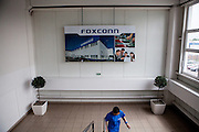 Entrance hall to one of the Foxconn buildings in Pardubice, Czech Republic. Foxconn Technology Group, is a multinational electronics contract manufacturing company headquartered in New Taipei, Taiwan. Foxconn is the world's largest electronics contractor manufacturer, and the third-largest information technology company by revenue.