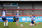 Kayleigh Green (Brighton & Hove) passes the ball across to Aileen Whelan (Brighton & Hove) during the FA Women's Super League match between Brighton and Hove Albion Women and Arsenal Women FC at The People's Pension Stadium, Crawley, England on 12 January 2020.