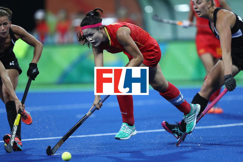 RIO DE JANEIRO, BRAZIL - AUGUST 13:  Qiuxia Cui of Chinq takes the ball forwrd  in the Women's Pool A match between the People's Republic of China and New Zealand on Day 8 of the Rio 2016 Olympic Games at the Olympic Hockey Centre on August 13, 2016 in Rio de Janeiro, Brazil.  (Photo by Phil Walter/Getty Images)