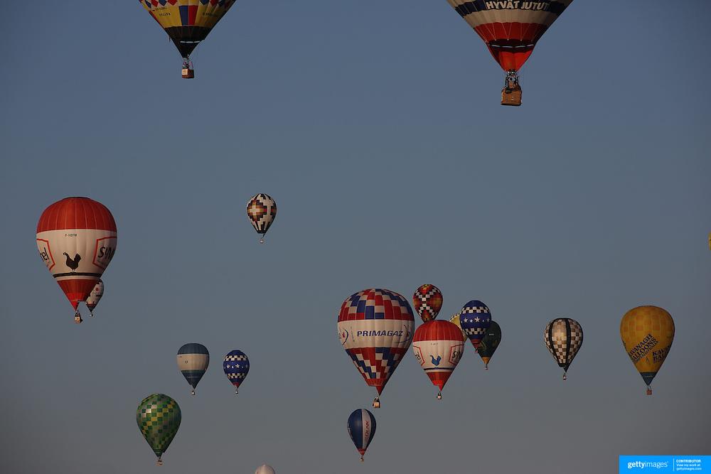 Hot Air balloons take to the skies around rural Michigan near Battle Creek during the World Hot Air Ballooning Championships. Battle Creek, Michigan, USA. 21st August 2012. Photo Tim Clayton