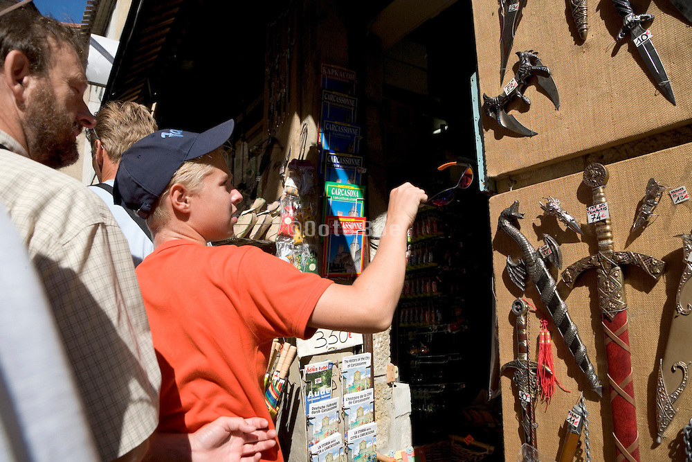 teenager at a tourist destination looking for a souvenir