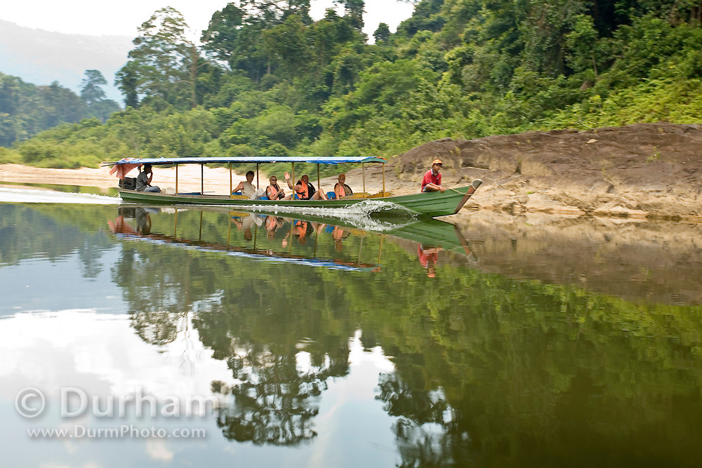 Tourists ride a jungle boat along the Endau River on their way to Endau-Rompin National Park, Malaysia.