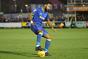 AFC Wimbledon midfielder Liam Trotter (14) dribbling during the EFL Sky Bet League 1 match between AFC Wimbledon and Southend United at the Cherry Red Records Stadium, Kingston, England on 1 January 2018. Photo by Matthew Redman.